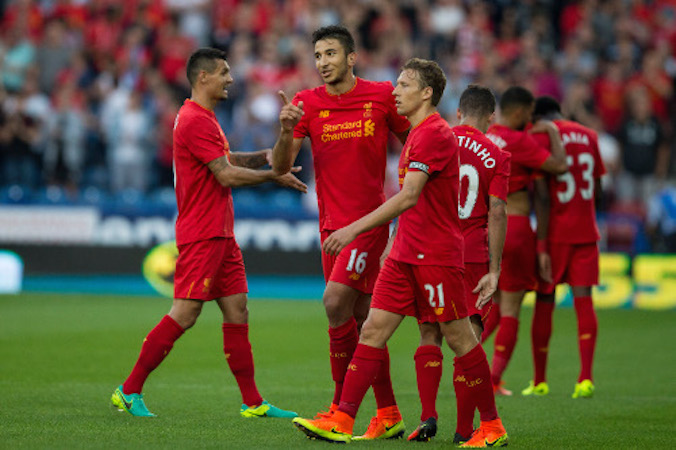 Liverpool cruise past Huddersfield Town