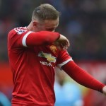 Rooney benched for Slovenia clash