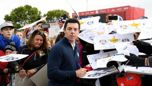CHASKA, MN - SEPTEMBER 27:  Rory McIlroy of Europe signs autoraphs after practice prior to the 2016 Ryder Cup at Hazeltine National Golf Club on September 27, 2016 in Chaska, Minnesota.  (Photo by Ross Kinnaird/Getty Images)