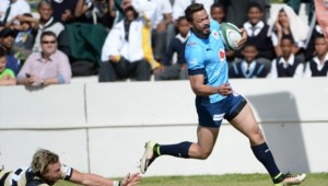 Bjorn Basson darts away from a Boland defender