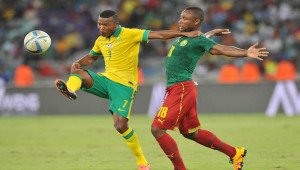 Mandla Masango of South Africa challenged by Sebastien Clovis Siani of Cameroon during the 2017 AFCON Qualifier match between South Africa and Cameroon at Moses Mabhida Stadium, Durban Kwa-Zulu Natal on 29 March 2016 ©Muzi Ntombela/Backpagepix