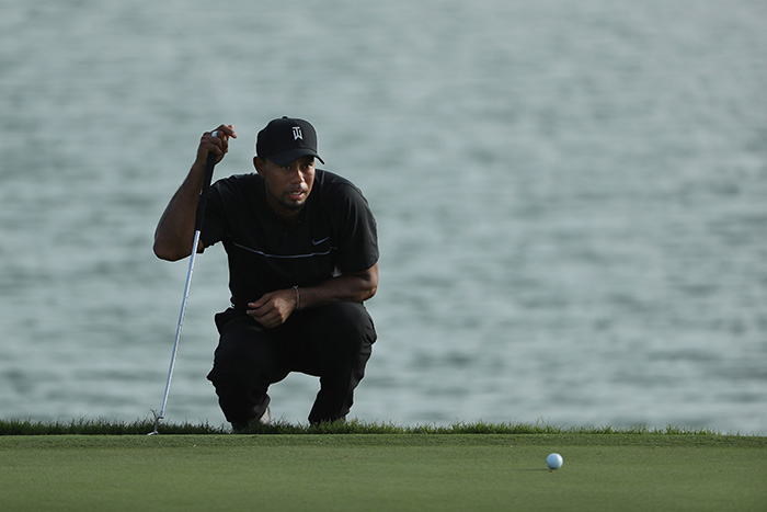 Woods survives, Oosthuizen on point