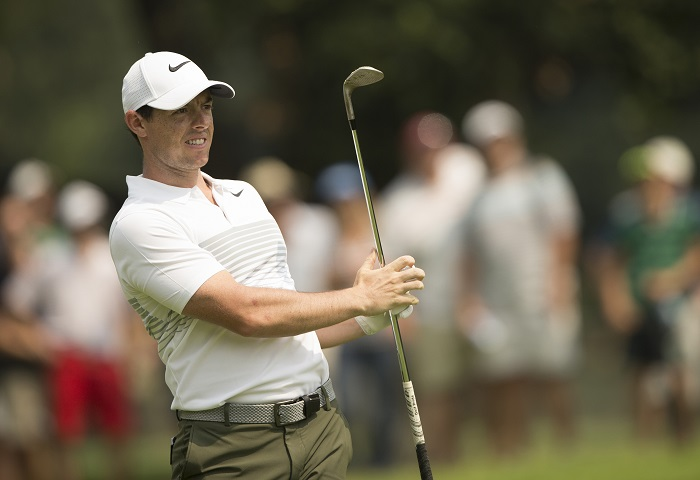 Back problem clouds breath-taking McIlroy display