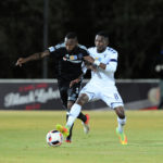 Mpho Makola is challenged by Thabang Monare