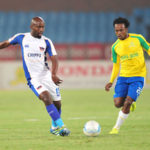 Sandal Zuke challenged by Percy Tau