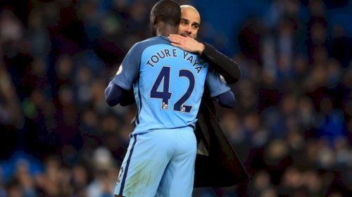 Manchester City midfielder Yaya Toure and manager Pep Guardiola