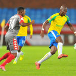 Hlompho Kekana tackled by Mandla Masango