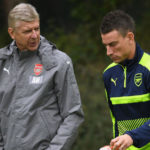 Arsene Wenger and Laurent Koscielny