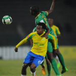 Percy Tau of Mamelodi Sundowns is challenged by Olaleng Shaku of Baroka