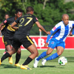 Kurt Lentjies challenged by Tshepo Gumede in the Absa Premiership