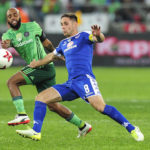 Dean Furman keeps Oupa Manyisa at bay