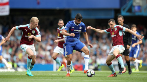 Diego Costa and Dean Marney battle for the ball
