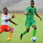 Bukhosi Sibanda tackled by Boyd Musonda