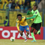 Percy Tau challenged by Bopunga Botuli