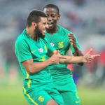 Riyaad Norodien celebrates his goal with Thabo Cele