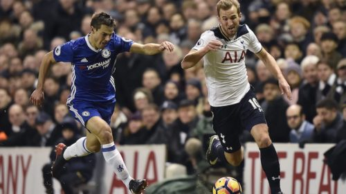 Cesar Azpilicueta vies for the ball with Harry Kane