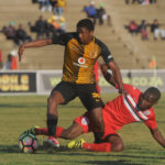 Itumeleng Shopane is tackled by Makhehleni Makhaula