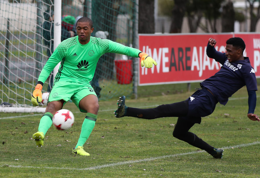 Jody February clears ball from Vincent Pule