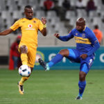 Bhongolwethu Jayiya battles for the ball with Vincent Kobola