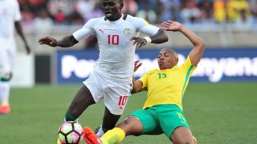 Sadio Mane tackled by Andile Jali