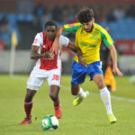Fares Hachi challenged by Aubrey Funga