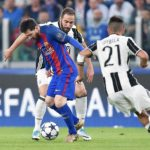Gonzalo Higuain in action against Lionel Messi