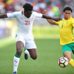 Keagan Dolly challenged by Lamine Gassama