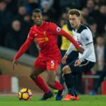Georginio Wijnaldum in action with Christian Eriksen