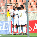 Vincent Pule celebrates a goal with teammates
