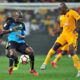 Hlompho Kekana challenged by Willard Katsande