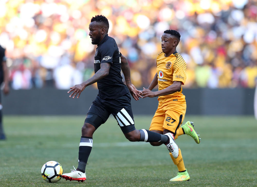 Mpho Makola of Orlando Pirates challenged by Hendrick Ekstein of kaizer Chiefs in the last Carling Black Label Cup.