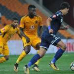 Ahmed Amr Gamal challenged by Kgotso Moleko