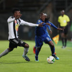 Reneilwe Letsholonyane and Nathan Sinkala challenge for the ball
