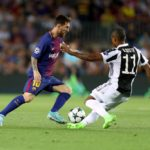 Lionel Messi vies for the ball with Douglas Costa