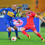 Dean Furman of Supersport United challenged by Robyn Johannes