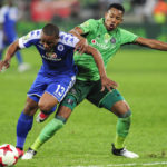 Thuso Phala gets past the defence of Happy Jele