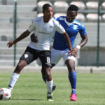 Jamie Webber evades a challenge from Khomotso Masia