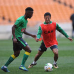 Phakamani Mahlambi challenges Keagan Dolly for the ball