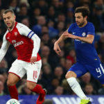 Arsenal hold Chelsea in first leg