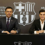 Philippe Coutinho signing his Barcelona contract