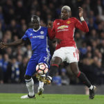 N'Golo Kante of Chelsea vies for the ball against Paul Pogba of Manchester United.
