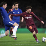 Andreas Christensen and Lionel Messi battle for the ball