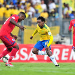 Percy Tau challenged by Morgan Gould