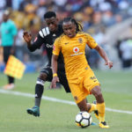 Siphiwe Tshabalala challenged by Innocent Maela