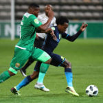 Percy Tau evades a challenge from Mlungisi Mbunjana