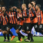 Fred celebrates with teammates after scoring for Shakhtar Donetsk.