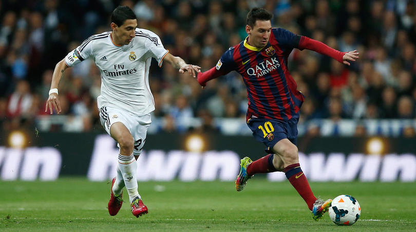 Lionel Messi goes past Angel Di Maria