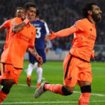 Mohamed Salah celebrates scoring the second goal with Roberto Firmino