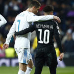 Cristiano Ronaldo and Neymar embrace at half time