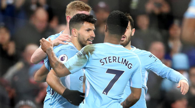 Sergio Aguero celebrates with teammates after scoring his third goal